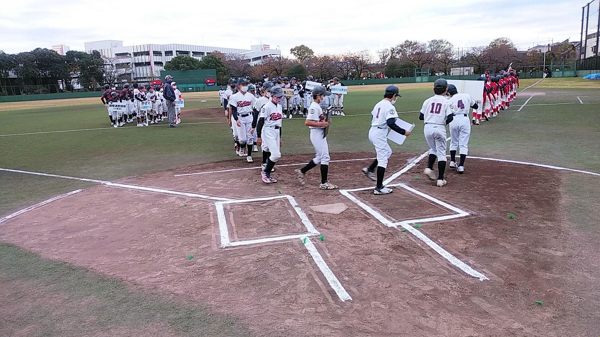 グランドを一周する田島少年野球部